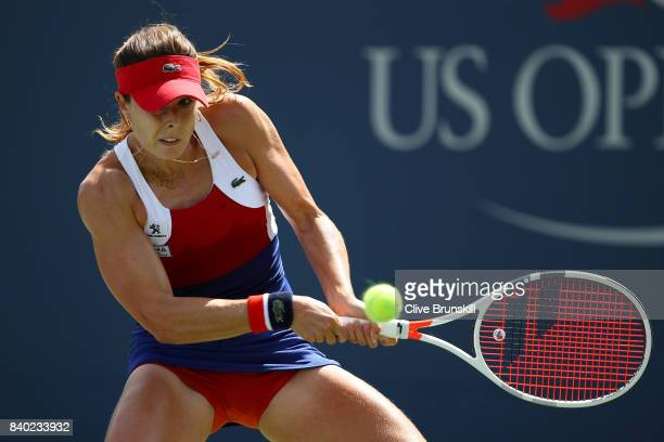 Alize Cornet of France returns a shot during her first round Women's Singles match against Heather Watson of Great Britain on Day One of the 2017 US...