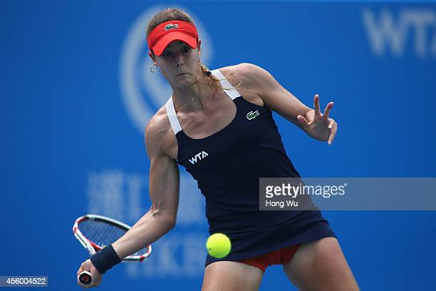 Alize Cornet of France returns a shot during her match against Kirsten Flipkens of Belgium during day four of the 2014 Dongfeng Motor Wuhan Open at...