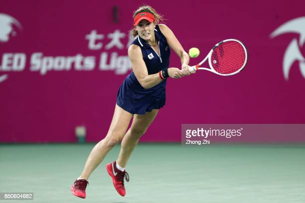 Alize Cornet of France returns a shot during the match against Yanina Wickmayer of Belgium on Day 4 of WTA Guangzhou Open on September 21 2017 in...