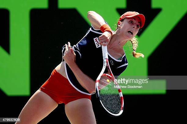 Alize Cornet of France returns a shot to Andrea Petkovic of Germany during the Sony Open at the Crandon Park Tennis Center on March 21 2014 in Key...