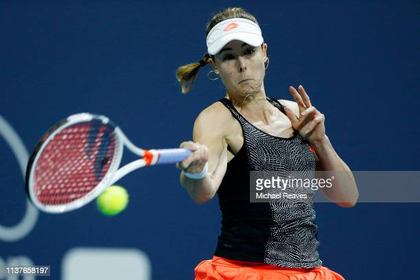 Alize Cornet of France returns a shot to Mihaela Buzarnescu of Romania during Day 5 of the Miami Open Presented by Itau at Hard Rock Stadium on March...
