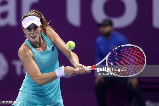 Alize Cornet of France returns the ball to Karolina Pliskova of the Czech Republic as they compete in their singles match during the second round of...