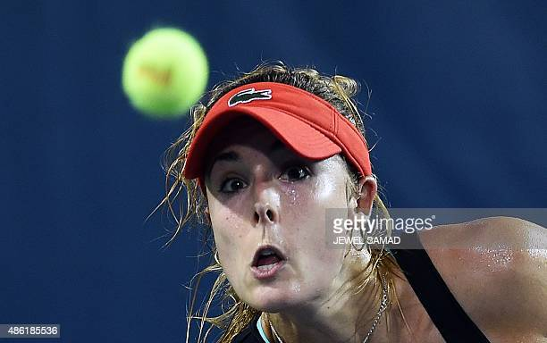 Alize Cornet of France returns to Kurumi Nara of Japan during their Women's Singles round 1 match of the US Open at USTA Billie Jean King National...
