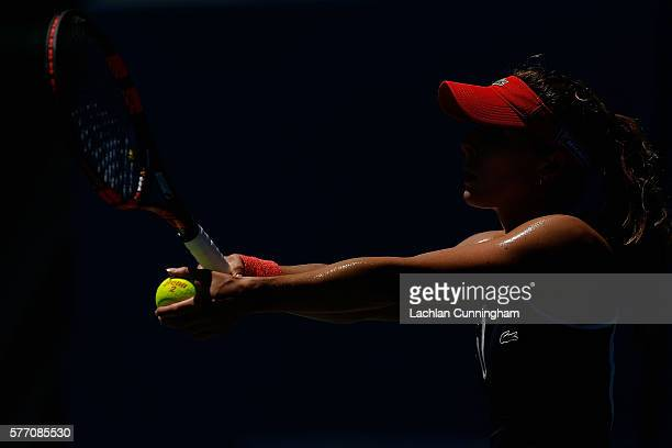 Alize Cornet of France serves against Jennifer Brady of the United States during day one of the Bank of the West Classic at the Stanford University...