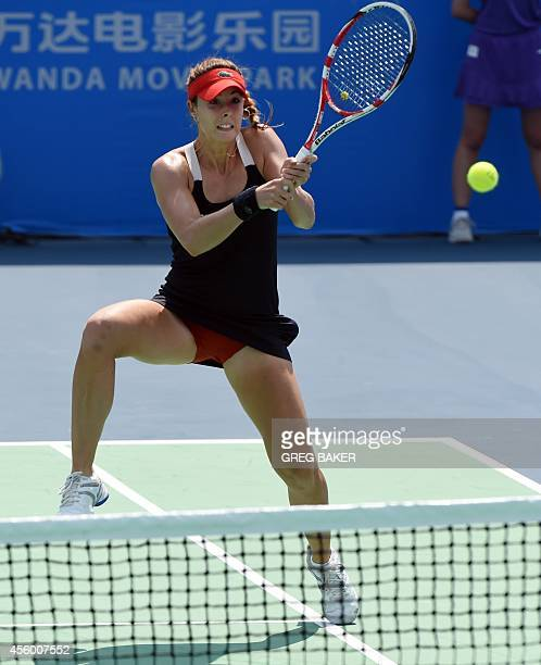 Alize Cornet of France serves during her match against Belgium's Kirsten Flipkens at the Wuhan Open tennis tournament in Wuhan in China's Hubei...