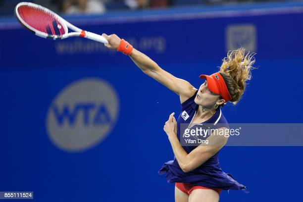 Alize Cornet of France serves during the ladies singles semi final match against Maria Sakkari of Greece on Day 5 of 2017 Dongfeng Motor Wuhan Open...