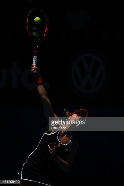 Alize Cornet of France serves in her singles match against Agnieszka Radwanska of Poland during day six of the 2015 Hopman Cup at Perth Arena on...