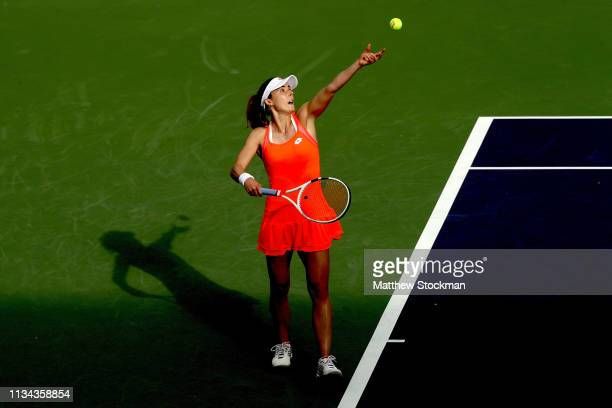 Alize Cornet of France serves to Ajla Tomljanovic of Australia during the BNP Paribas Open at the Indian Wells Tennis Garden on March 07 2019 in...