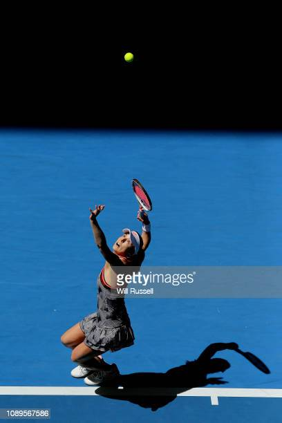 Alize Cornet of France serves to Garbine Muguruza of Spain in the women's singles match during day seven of the 2019 Hopman Cup at Perth Arena on...
