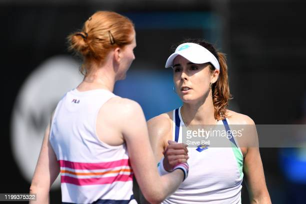 Alize Cornet of France shakes hands after winning her first round match against Alison Van Uytvanck of Belgium during day four of the 2020 Hobart...