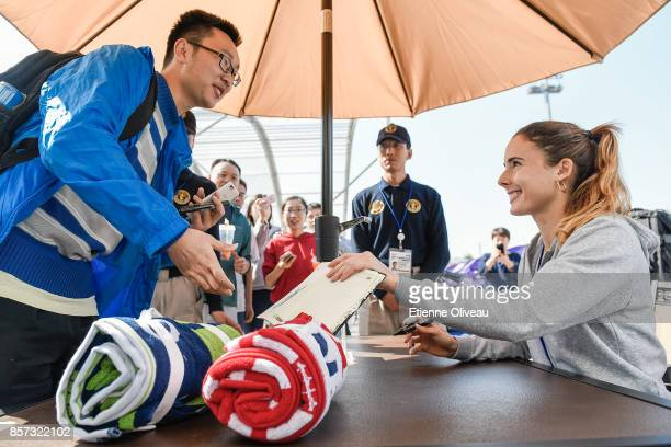 Alize Cornet of France signs an autograph at the merchandise booth on day five of the 2017 China Open at the China National Tennis Centre on October...
