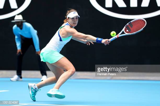 Alize Cornet of France stretches to play a backhand during her Women's Singles second round match against Donna Vekic of Croatia on day four of the...