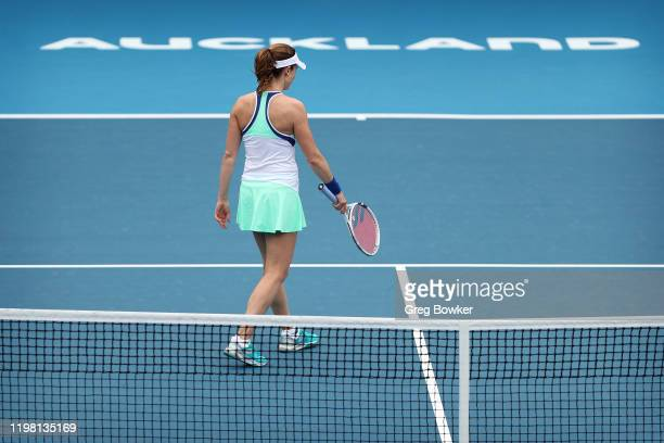 Alize Cornet of France walks away from the net after losing a close game during her second round match against Petra Martic of Croatia during day...