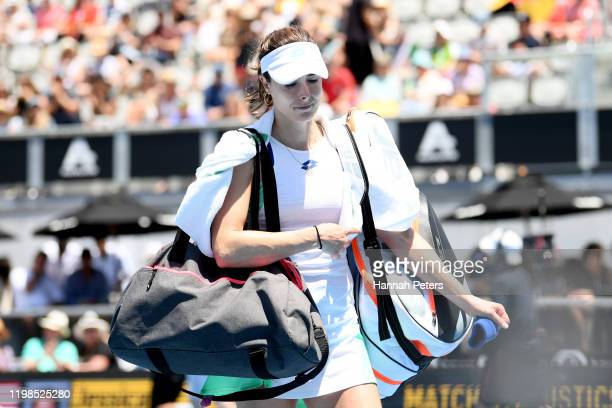 Alize Cornet of France walks off after retiring hurt during her quarter final match against Jessica Pegula of USA during day five of the 2020 Women's...