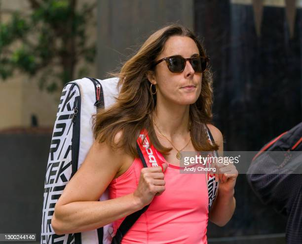 Alize Cornet of France walks past the Grand Hyatt Hotel in Melbourne on February 04, 2021 in Melbourne, Australia. Victoria has reintroduced COVID-19...