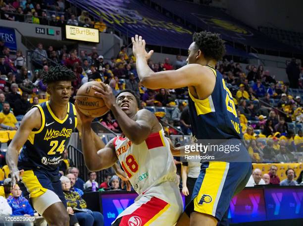 Alize Johnson and Ben Moore of the Fort Wayne Mad Ants battles Jordan Sibert of the College Park Skyhawks on March 6, 2020 at Memorial Coliseum in...
