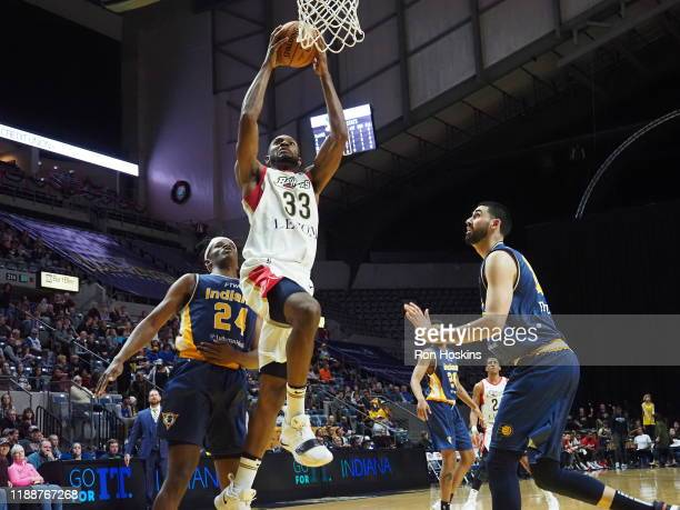 Alize Johnson and Goga Bitadze of the Fort Wayne Mad Ants defend Vitto Brown of the Erie Bayhawks on December 14 2019 at Memorial Coliseum in Fort...