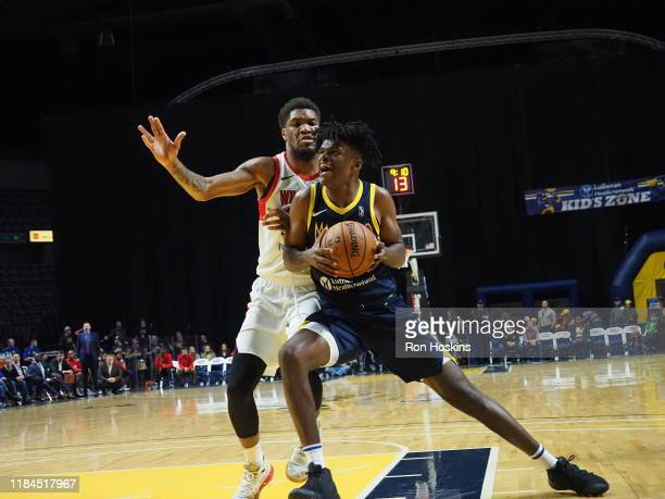 Alize Johnson of the Fort Wayne Mad Ants battles Darel Proirier of the Windy City Bulls on November 24 2019 at Memorial Coliseum in Fort Wayne...