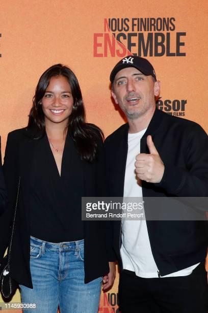 """Alize Lim and Gad Elmaleh attend the """"Nous finirons ensemble"""" Premiere at Cinema Gaumont Capucines on April 29, 2019 in Paris, France."""