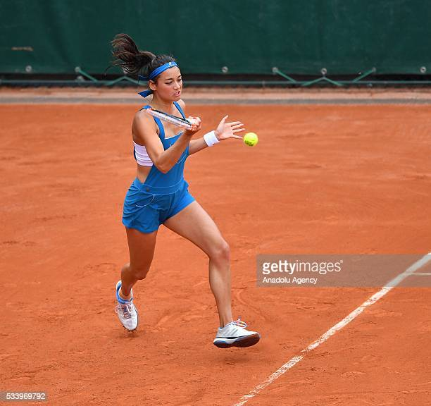 Alize Lim of France in action during women's single first round match against Camila Giorgi of Italy at the French Open tennis tournament at Roland...