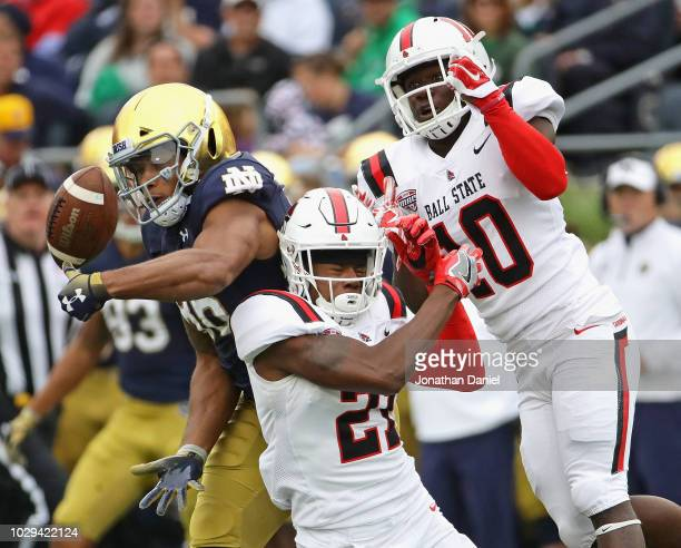 Alize Mack of the Notre Dame Fighting Irish can't hold onto the ball under pressure from Antonio Phillips and Lamar Anderson of the Ball State...