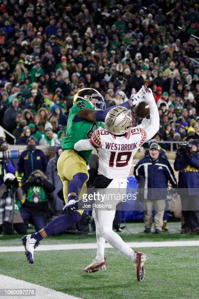 Alize Mack of the Notre Dame Fighting Irish makes a fiveyard touchdown reception against AJ Westbrook of the Florida State Seminoles in the first...