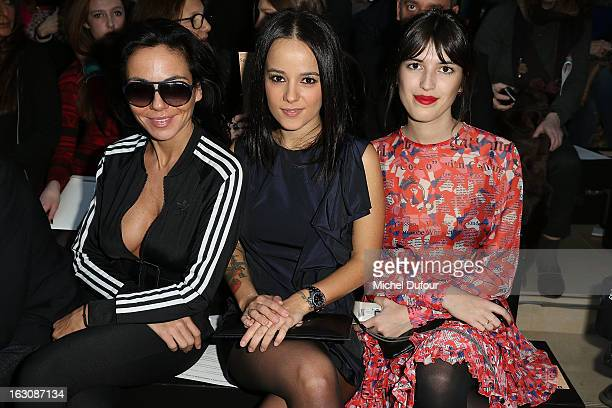 Alizee and Jeanne Damas attend the John Galliano Fall/Winter 2013 ReadytoWear show as part of Paris Fashion Week at Le Centorial on March 3 2013 in...