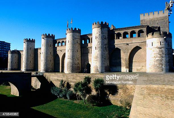 'Aljaferia Palace by Mudejar craftsmen from 1118 12th15th Century masonry and stones Spain Zaragoza Whole artwork view The half round towers of the...