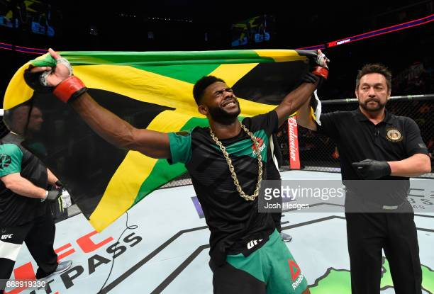 Aljamain Sterling celebrates his victory over Augusto Mendes of Brazil in their bantamweight fight during the UFC Fight Night event at Sprint Center...