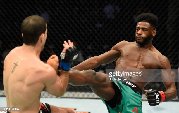 Aljamain Sterling kicks Augusto Mendes of Brazil in their bantamweight fight during the UFC Fight Night event at Sprint Center on April 15 2017 in...