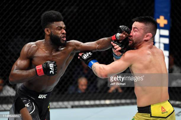 Aljamain Sterling punches Pedro Munhoz of Brazil in their bantamweight bout during the UFC 238 event at the United Center on June 8 2019 in Chicago...