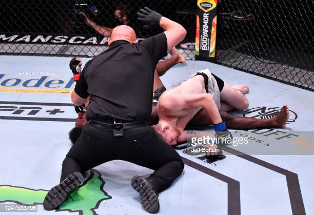 Aljamain Sterling secures a rear choke submission against Cory Sandhagen in their bantamweight bout during the UFC 250 event at UFC APEX on June 06...