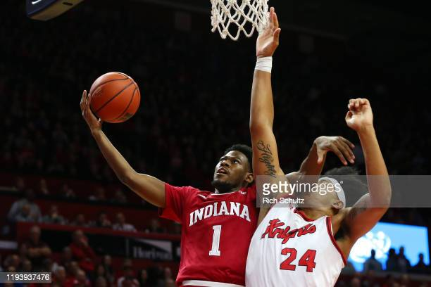 Aljami Durham of the Indiana Hoosiers attempts a layup as Ron Harper Jr. #24 of the Rutgers Scarlet Knights defends during the first half of a...