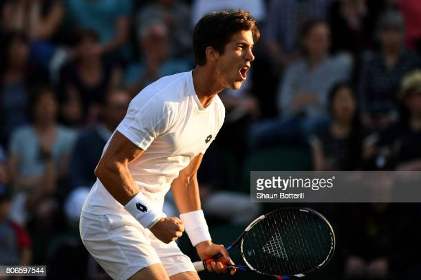 Aljaz Bedene of Great Britain celebrates during the Gentlemen's Singles first round match against Ivo Karlovic of Croatia on day one of the Wimbledon...
