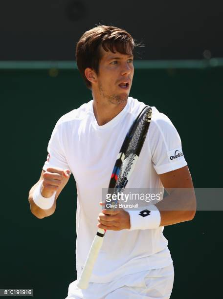 Aljaz Bedene of Great Britain celebrates during the Gentlemen's Singles third round match against Gilles Muller of Luxembourg on day five of the...
