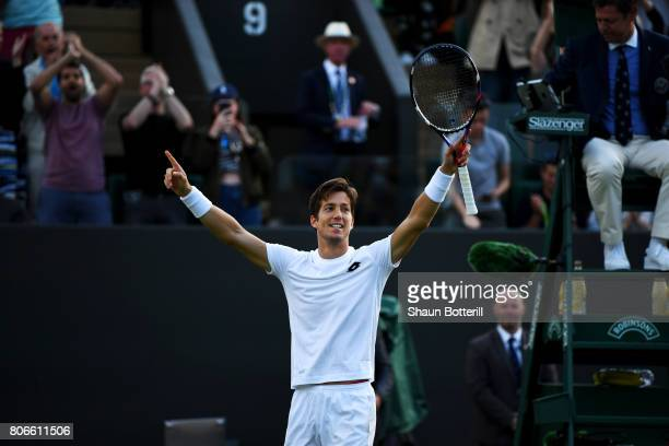 Aljaz Bedene of Great Britain celebrates victory after the Gentlemen's Singles first round match against Ivo Karlovic of Croatia on day one of the...