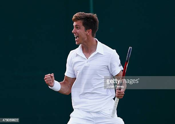 Aljaz Bedene of Great Britain celebrates winning his Gentlemens Singles first round match against Radek Stepanek of the Czech Republic during day two...