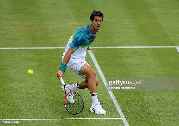 Aljaz Bedene of Great Britain hits a backhand during his second round match against Andy Murray of Great Britain on day four of The Aegon...