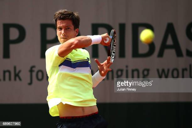 Aljaz Bedene of Great Britain hits a forehand during the first round match against Ryan Harrison of The USA on day two of the 2017 French Open at...
