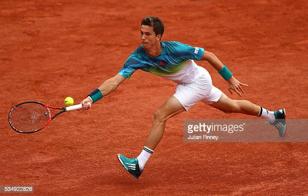 Aljaz Bedene of Great Britain hits a forehand during the Men's Singles third round match against Novak Djokovic of Serbia on day seven of the 2016...