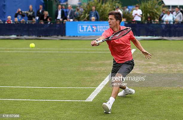 Aljaz Bedene of Great Britain in action against Adrian Mannarino of France on day three of the Aegon Open Nottingham at Nottingham Tennis Centre on...
