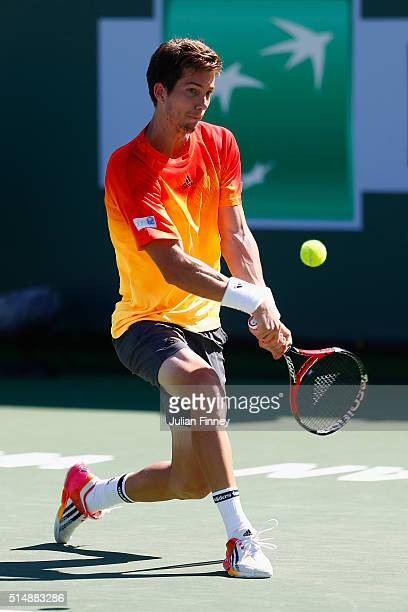 Aljaz Bedene of Great Britain in action against Mikhail Youzhny of Russia during day five of the BNP Paribas Open at Indian Wells Tennis Garden on...