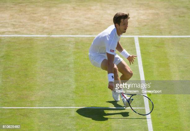 Aljaz Bedene of Great Britain in action during his defeat by Gilles Muller of Luxembourg in their Men's Singles Third Round Match at Wimbledon on...