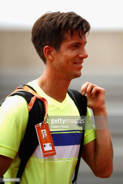 Aljaz Bedene of Great Britain leaves the court following victory in the mens singles first round match against Ryan Harrison of The United States...