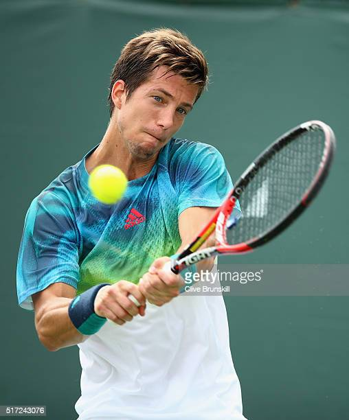 Aljaz Bedene of Great Britain plays a backhand against Baena Carballes of Spain in their first round match during the Miami Open Presented by Itau at...