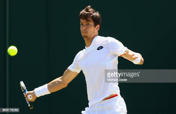 Aljaz Bedene of Great Britain plays a forehand during the Gentlemen's Singles second round match against Damir Dzumhur of Bosnia and Herzegovinia on...