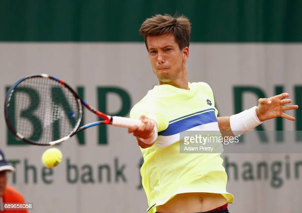 Aljaz Bedene of Great Britain plays a forehand during the mens singles first round match against Ryan Harrison of The United States on day two of the...