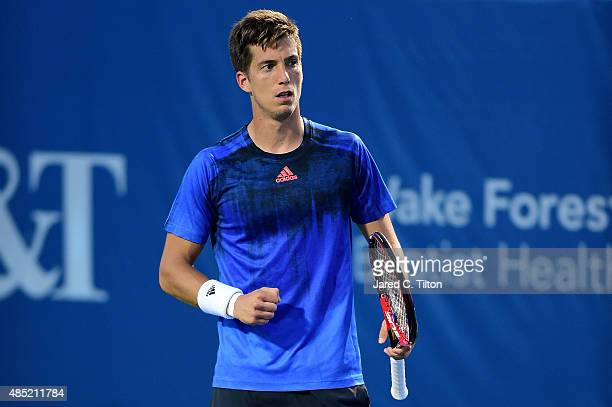 Aljaz Bedene of Great Britain reacts after a point against Gilles Simon of France during the second day of the WinstonSalem Open at Wake Forest...