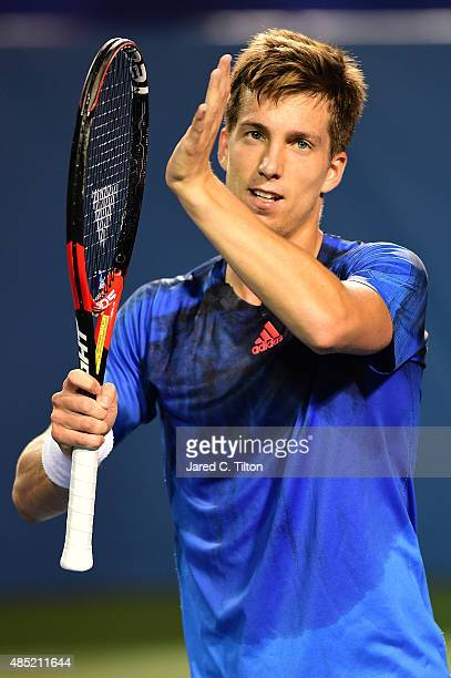Aljaz Bedene of Great Britain reacts after defeating Gilles Simon of France during the second day of the WinstonSalem Open at Wake Forest University...