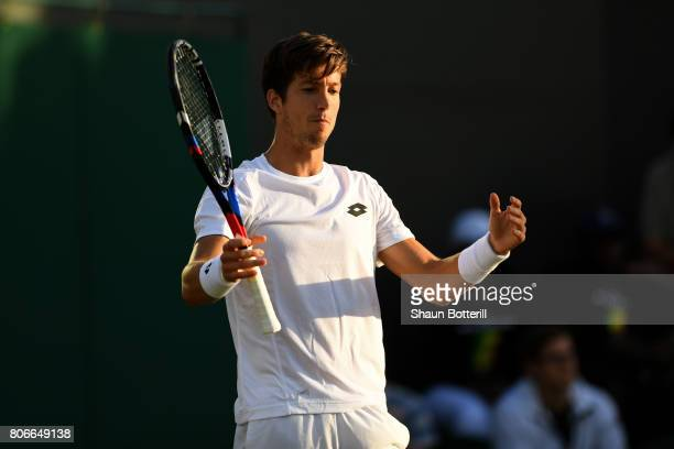 Aljaz Bedene of Great Britain reacts during the Gentlemen's Singles first round match against Ivo Karlovic of Croatia on day one of the Wimbledon...